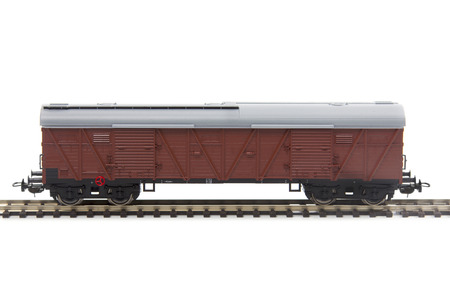 covered wagon: miniature model of a train wagon isolated over white background