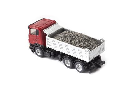 camion de basura: pesado cami�n de juguete aislado sobre fondo blanco Foto de archivo