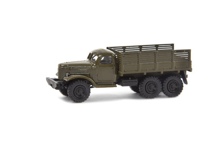 green plastic soldiers: miniature model of soviet military truck on white background
