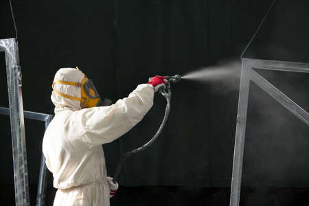 painter painting metal designs with airbrush Stock Photo