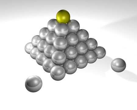 capping: Some stacked metallic spheres with a gold one capping the pyramid. Conceptual piece.
