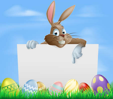 Easter bunny pointing at blank sign with painted chocolate Easter eggs in green field Illustration