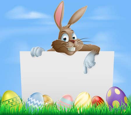 lapin blanc: Lapin de P�ques montrant signe blanc avec les oeufs peints de P�ques en chocolat dans le champ vert Illustration