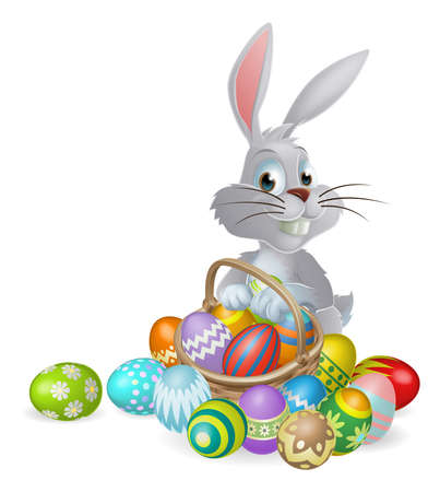 chocolate eggs: An Easter bunny white rabbit with a basket of painted chocolate Easter eggs