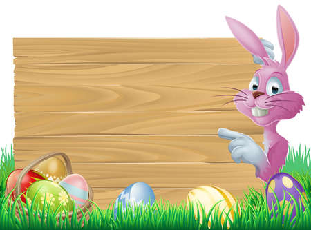 A cartoon pink Easter bunny rabbit peeping round a sign in green spring field full of chocolate decorated eggs Vector