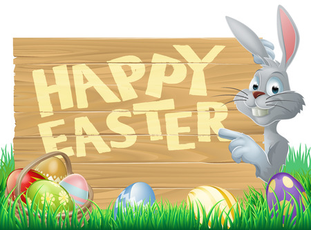 Easter bunny peeking round a sign and pointing, chocolate Easter eggs in the foreground Vector