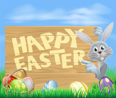 rabit: Cartoon Easter rabbit bunny pointing at a Happy Easter sign, chocolate decorated Easter eggs and basket in front