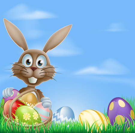 rabit: Easter bunny rabbit in a field with a basket of chocolate Easter eggs with copyspace in the sky