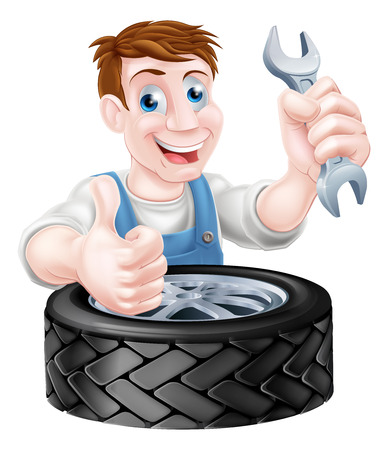 Mechanic holding spanner and giving a thumbs up behind a tyre