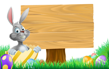 buny: A cartoon Easter Bunny coming out of a decorated chocolate Easter egg next to a wooden sign