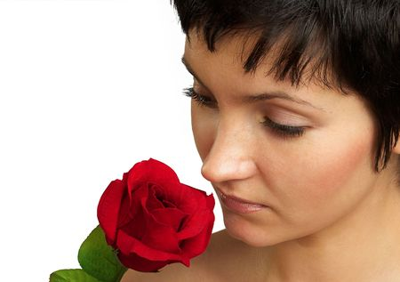 Beautiful woman with a flower. Portrait. Close-up. photo