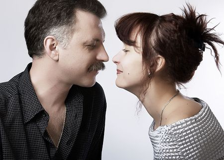 Loving adult couple, beautiful and happy. Half face. photo