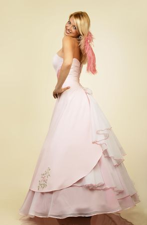 Beautiful young woman in evening dress.