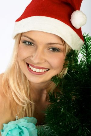 Attractive Xmas woman with a santa cap. Close-up portrait.  photo