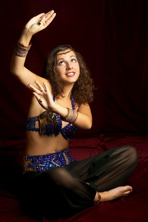Beautiful dancing eastern woman.More images of this attractive model and other one you can find in my portfolio. WELCOME!!! WELCOME!!! WELCOME!!! Stock Photo - 309654