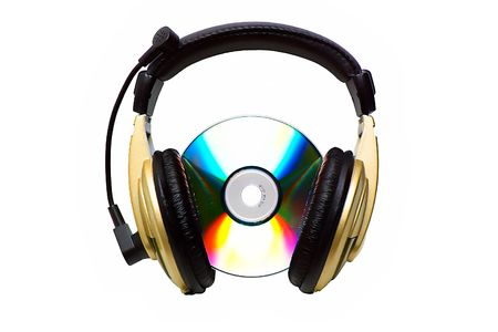 Cd-rom and a golden headphone. photo