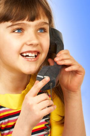 Funny girl speaking by phone. Stock Photo - 326944