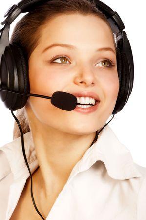 Sonriente atractiva mujer con un auricular.  Foto de archivo