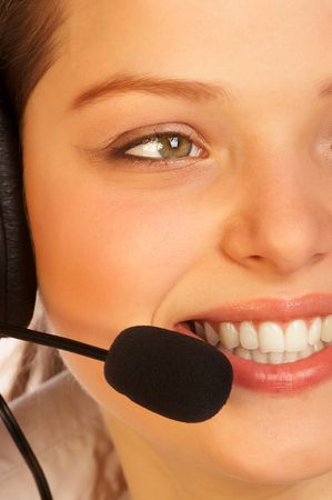 telephone saleswoman: Smiling attractive woman with a headset.