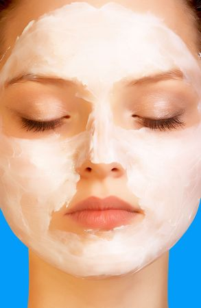 Attractive girl applying face pack.