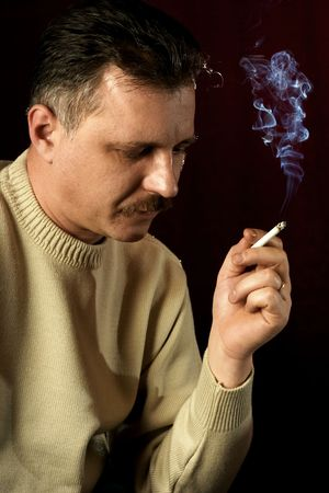 toxin: Man with a cigarette. Stock Photo