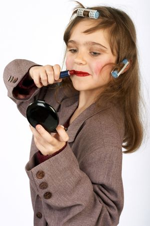 Cute little girl doing funny make-up.More images of this attractive model and other one you can find in my portfolio. WELCOME!!! WELCOME!!! WELCOME!!! photo