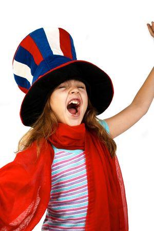 Funny little girl in a foolÂ's cap. photo