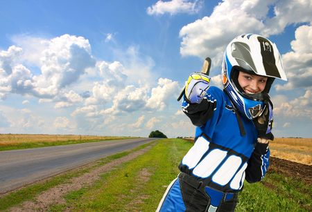 Attractive sexy woman in motoracer uniform. More images of this attractive model and other one you can find in my portfolio. WELCOME!!! WELCOME!!! WELCOME!!! photo