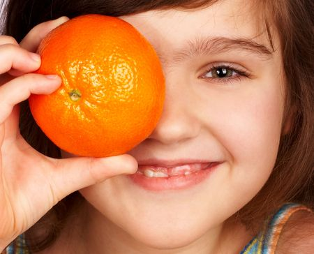 Funny child with an orange. Stock Photo