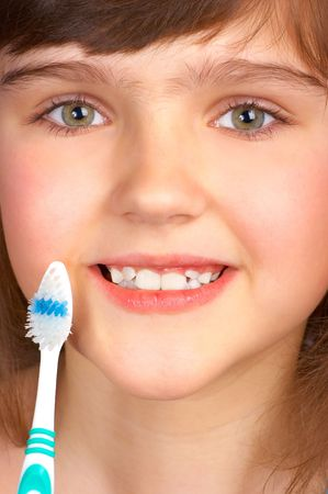 Pretty little girl with a tooth-brush. Stock Photo