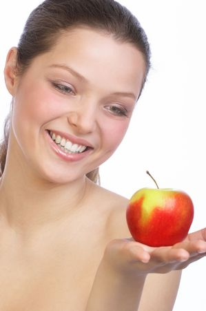 Beautiful young woman holding red apple photo