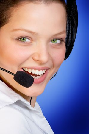 Young woman with a headset smiling photo