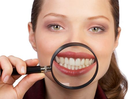 Smile and teeth of a beautiful young woman photo