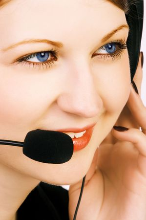 Face of a smiling attractive business woman with a headset. photo
