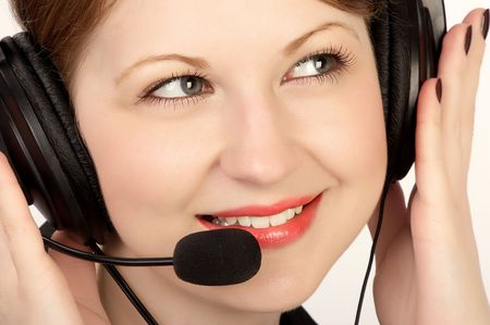 Smiling attractive business woman with a headset. photo