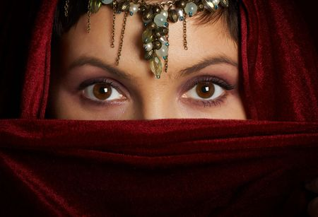 Mysterious eastern woman with beautiful eyes. Stock Photo - 486579