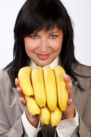 Happy young woman keeping to fruit diet photo