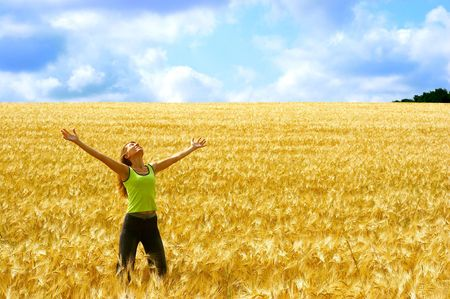 Happy young woman in the field Stock Photo - 492196