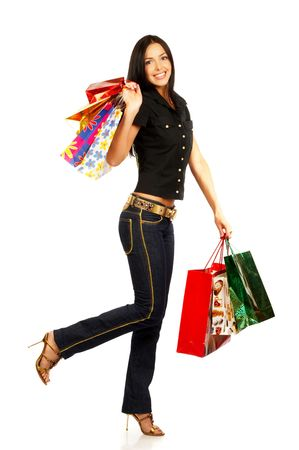 Shopping pretty woman with bags. Isolated over white background Stock Photo - 684654