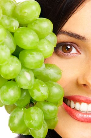 Beautiful young woman with green grape Stock Photo - 556682