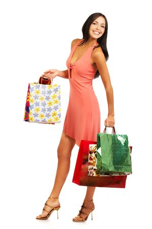 Christmas shopping pretty woman  with shopping bags. Isolated over white background photo