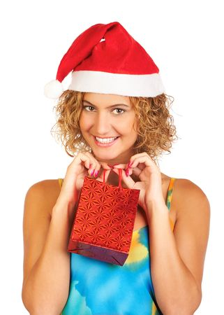 Pretty young woman in Santa cap holding a small gift bag    Stock Photo - 595917