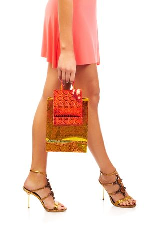 Shopping pretty woman. Isolated over white background Stock Photo - 595904