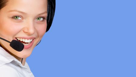 girls talk by phone: Smiling agent woman of a call center. Isolated over blue background with copyspace. Woman in Business Series. Stock Photo