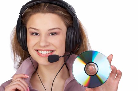 Business woman with headset holding CD-ROM. Isolated over white background photo