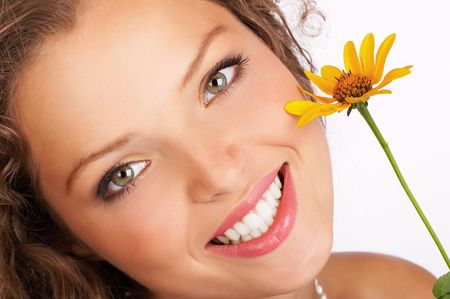 Pretty smiling woman with fresh  flower photo
