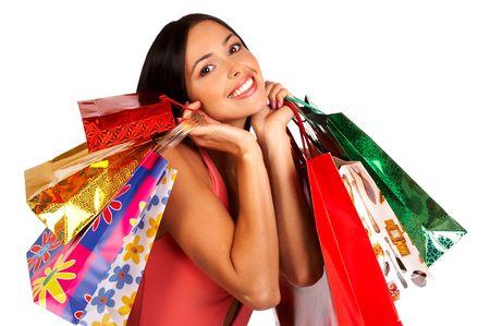 euforia: Compras de Navidad hermosa mujer con bolsas de la compra. Aisladas m�s de fondo blanco