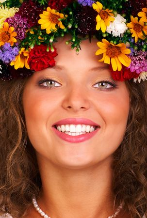 Pretty smiling woman with fresh  flowers. Isolated over white  photo