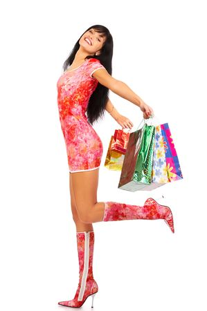Christmas shopping pretty woman  with shopping bags. Isolated over white background Stock Photo - 595288