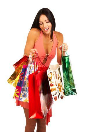 Achats de No�l jolie femme avec des sacs. Isol� sur fond blanc